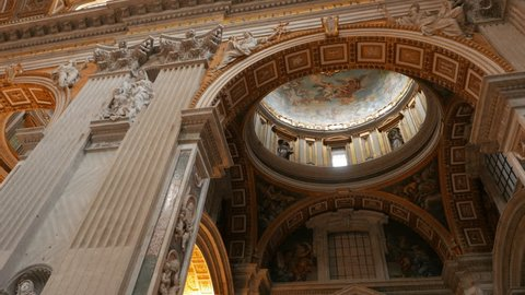a panning right interior view of saint peter's basilica in rome, italy