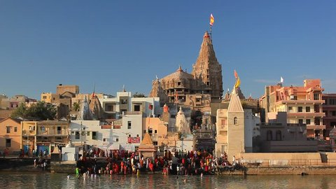 DWARKA, INDIA - JANUARY 3: Hindu pilgrims take a holy bath in the river Gomti. View of Gomti Ghat and Krishna temple Shree Dwarkadhish on January 3, 2016 in Dwarka