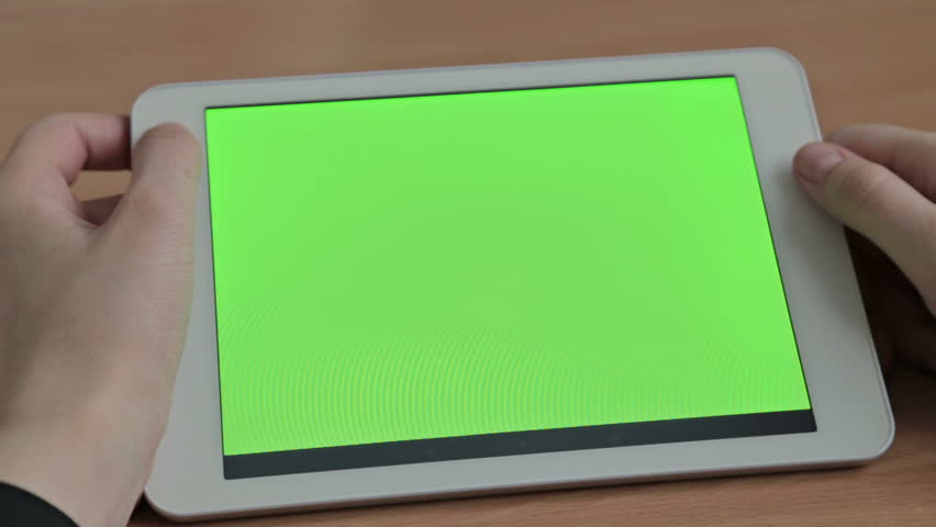 Woman watching videos on tablet, green screen | Shutterstock HD Video #14256920