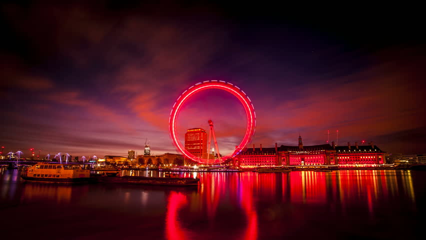 Night to day timelapse of London eye on the River Thames, London