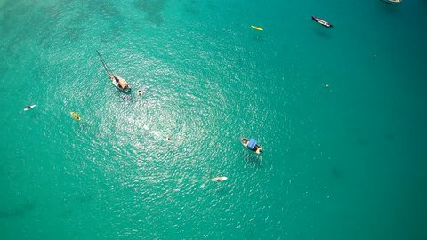 Aerial view of clear ocean waters along a tropical Beach featuring boats and Yachts in Barbados in the Caribbean