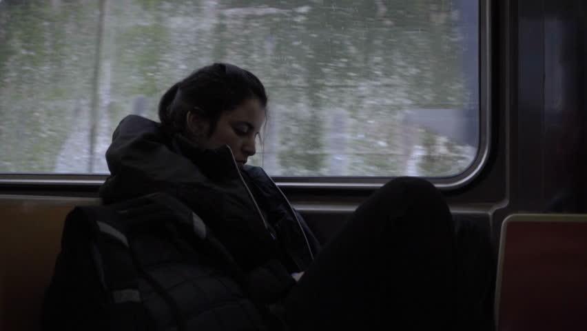 New york jan 25 2016 girl sitting alone sleeping or for Sleeping with window open in winter
