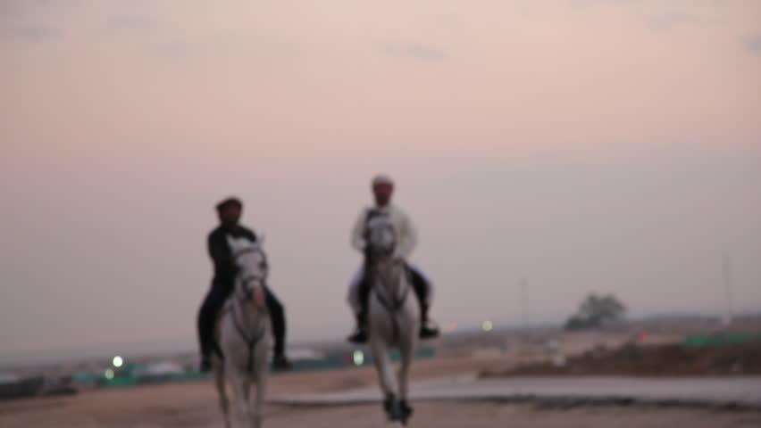 Al Amar, CIRCA January 2016: Arab Horsemen on desert during sunset. Bahrain 02 #14298250