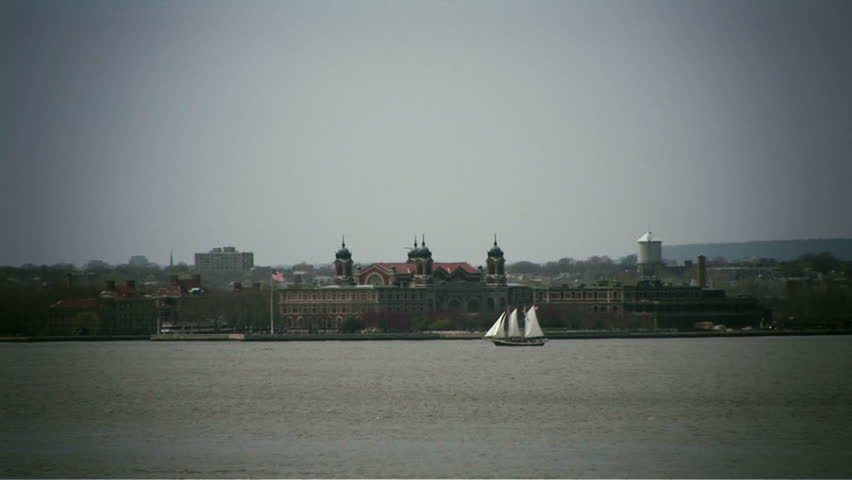 Ellis Island from across river & old sailboat in mid-ground