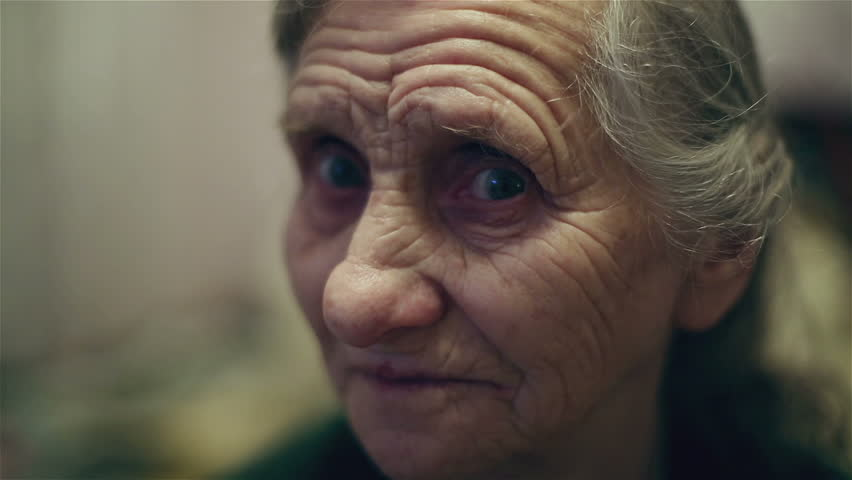 Happy grandmother face. Old woman smiling and laughing. Old woman face with deep wrinkles. Close up.