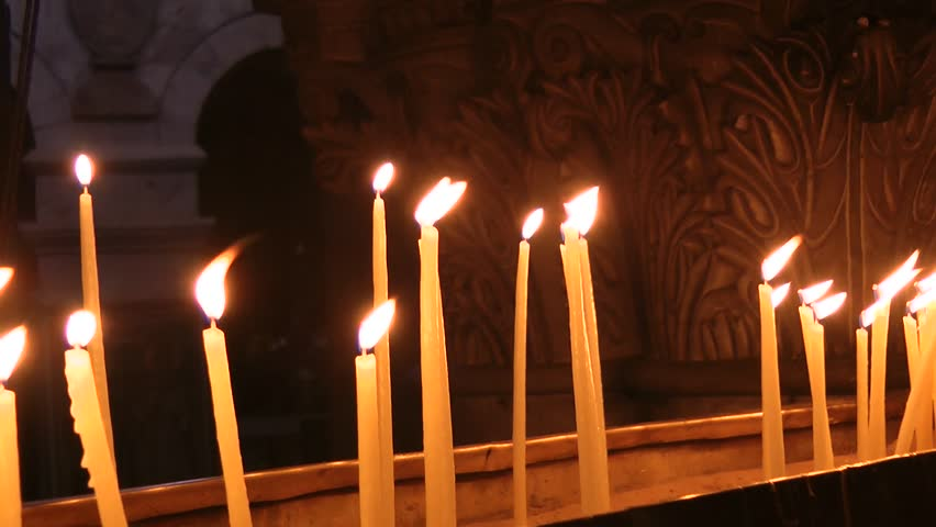 The candles flame in church of the Holy Sepulchre in Jerusalem | Shutterstock HD Video #14315104