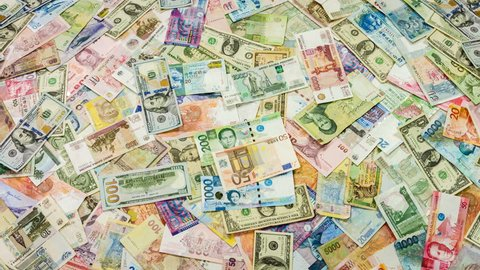 Colored banknotes of different countries closeup rotation.