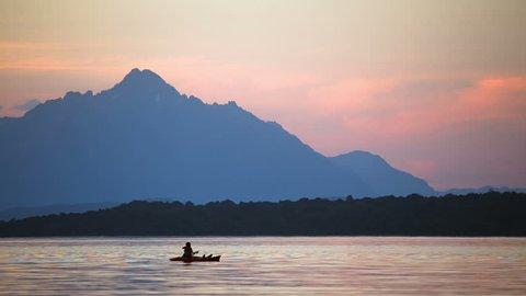 Man kayaking at the lake at sunset. Bariloche, Patagonia Argentina