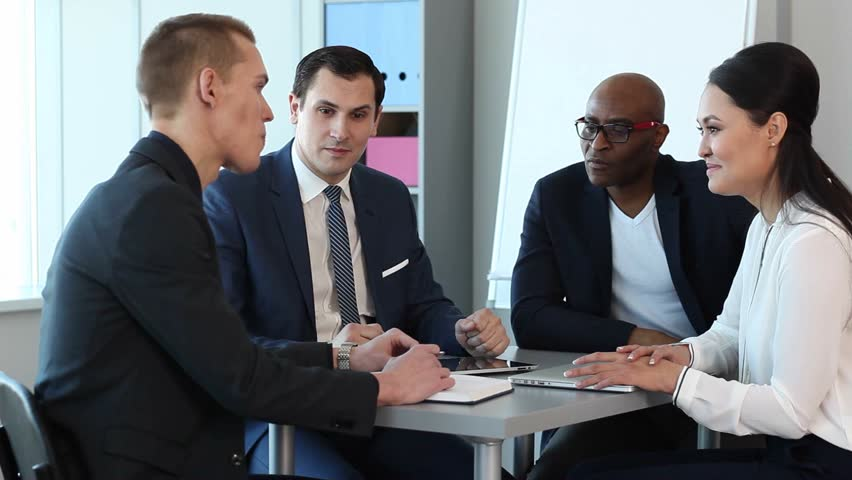 Businessmen discussing work issues/Discussion of Business Issues | Shutterstock HD Video #14339470