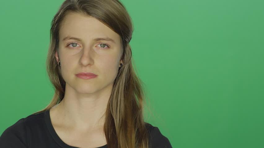 Young women looks sad, on a green screen studio background | Shutterstock HD Video #14361310
