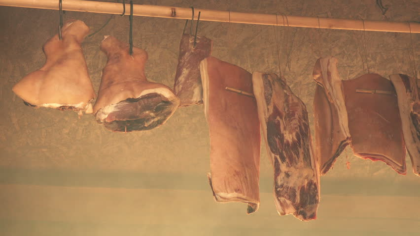 Smoking pork meat, ham and bacon, curing food preparation process in smokehouse. | Shutterstock HD Video #14398780