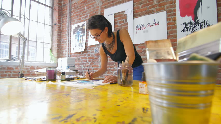Painter working in her beautiful wide slide