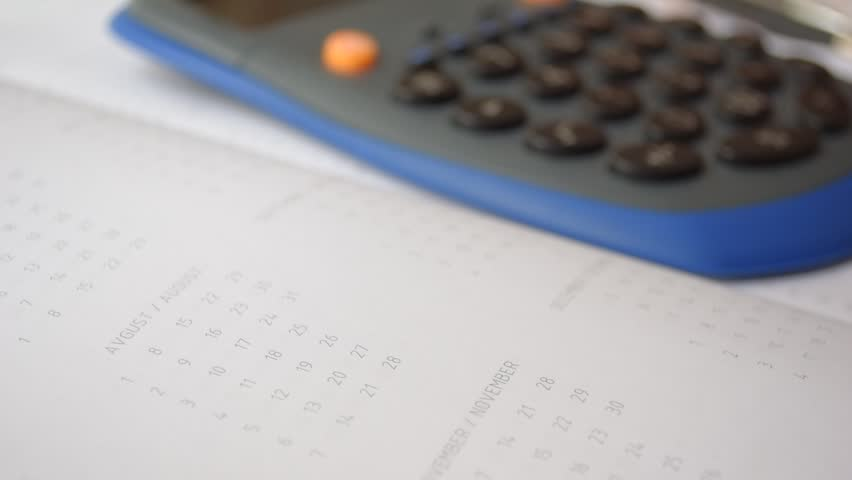 Using calculator on the diary | Shutterstock HD Video #14414995