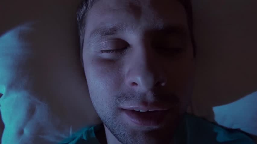 Snoring man in bed at home