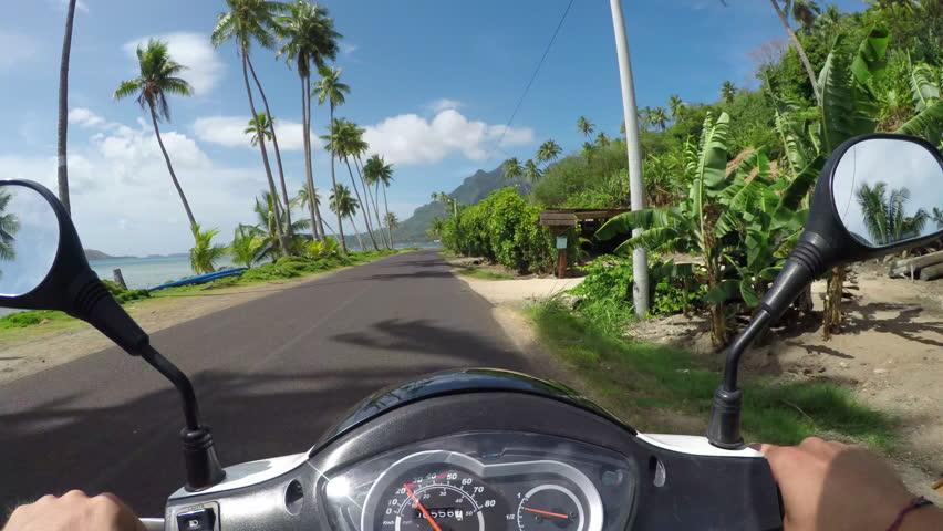 4K FIRST PERSON VIEW POV: Riding Vespa motor bike on sunny Bora Bora island resort | Shutterstock HD Video #14471953