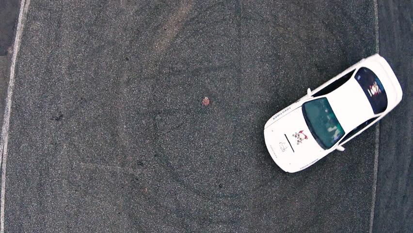 Ariel overhead shot drift sports car in a circle | Shutterstock HD Video #14510800