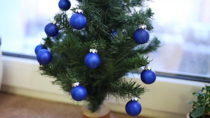 small decorative christmas tree with blue balls on windowsill hd stock video clip - Small Blue Christmas Tree