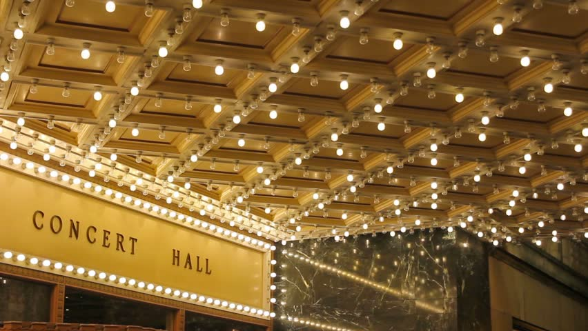 High definition movie of blinking concert hall theater ceiling lights on broadway along a entertainment street 1080p #14587321