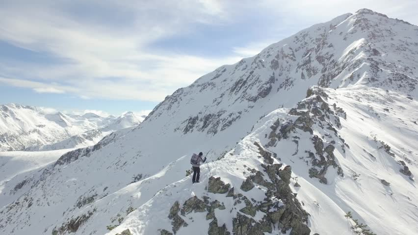 Aerial Flight Around Mountain Peak Hiker Climbing Up Steep Slope Difficult Dangerous Road Ladder To Success Achievement Struggle Danger Adventure Concept