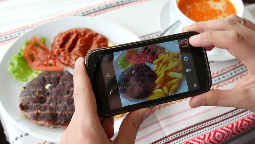 Take a photo picture of food with mobile phone camera and viewing sliding gallery