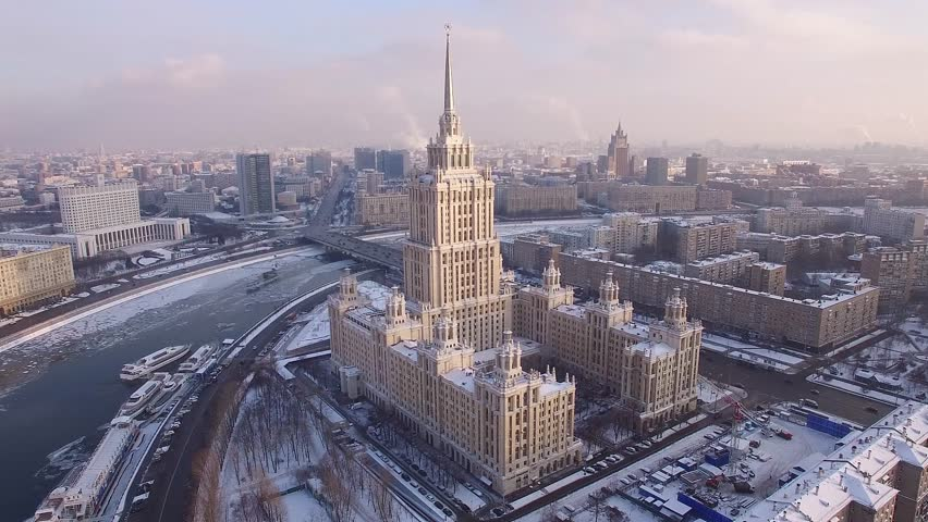 Beautiful frozen WINTER Moscow city cowered in snow and ice. Stalin skyscraper. Aerial FPV Drone Flights. UltraHD 4K