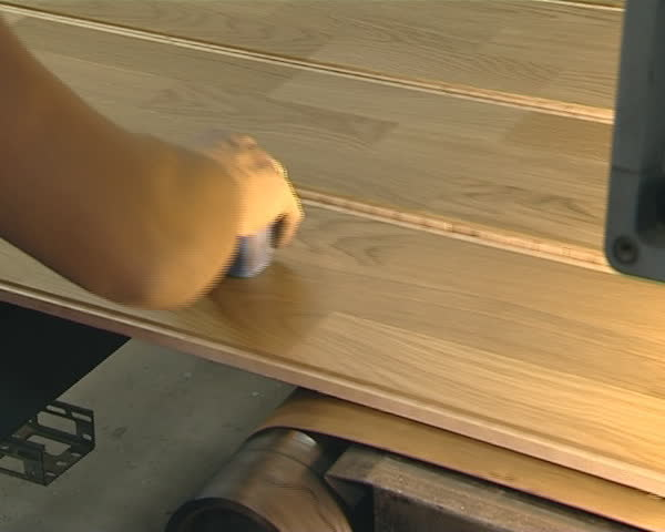 Quality control of floorboard produced in industrial factory. Human intervention in production required.