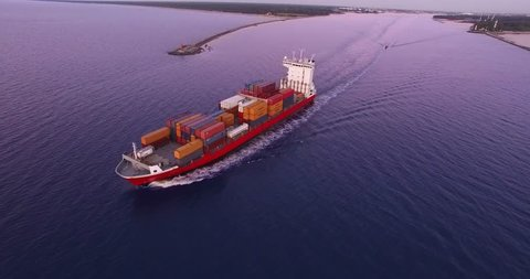 4K - To follow the cargo ship. Aerial view