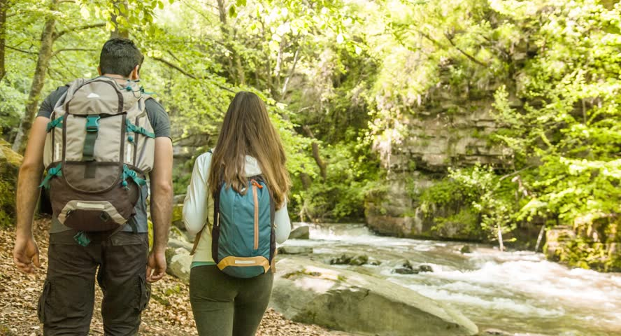 Hiking Couple Exploring Forest River Travel Nature Footage Man Woman Enjoying Adventurous Vacation Beauty Backpacker Tourist