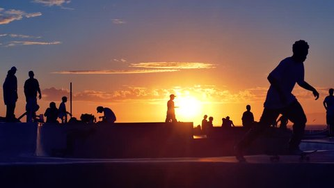 Silhouette Tourists Skateboarding Extreme Skatepark Sunset Footage Enjoyment Sunlight Youth Culture Sport Skateboard Recreation Vacation Los Angeles Skill Sky Orange