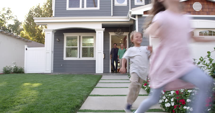 Family Coming Out Of Front Door Of Suburban Home Shot On R3D