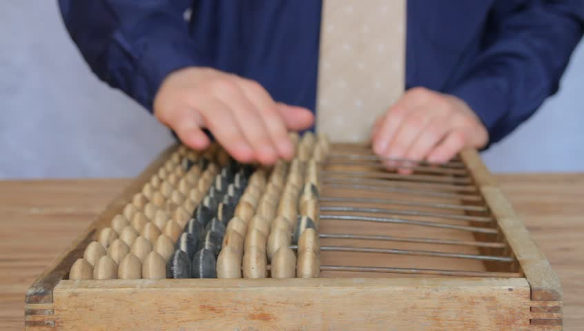 businessman using an abacus, focus on abacus