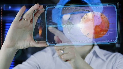 Doctor with futuristic hud screen tablet. Nano robot ovule to egg cell. Medical concept of the future
