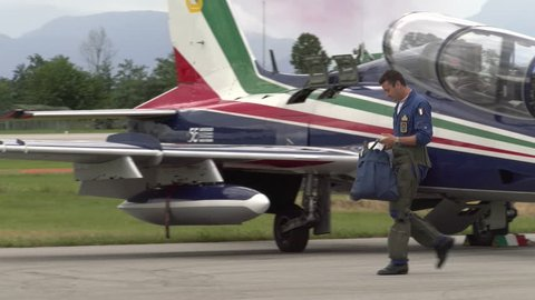 RIVOLTO, ITALY, SEPTEMBER 6: pilot going towards Aermacchi MB-339-A, plane of the aerobatic demonstration team of the Italian Aeronautica militare, before 55th anniversary event, on September 6, 2015