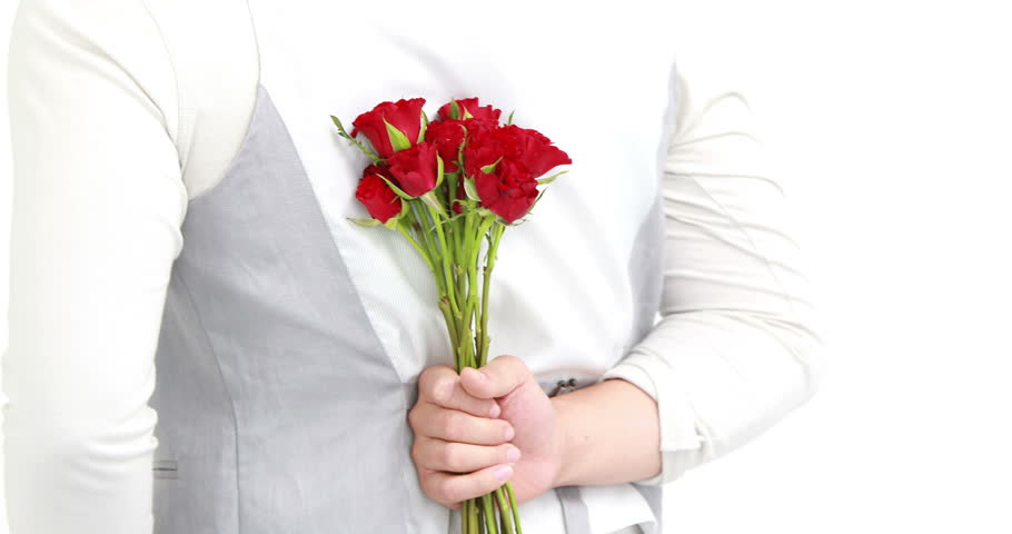 Man offering flowers to his girlfriend on white background | Shutterstock HD Video #14867821