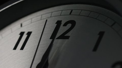 4K Slow zoom in as the clock strikes 12 o'clock