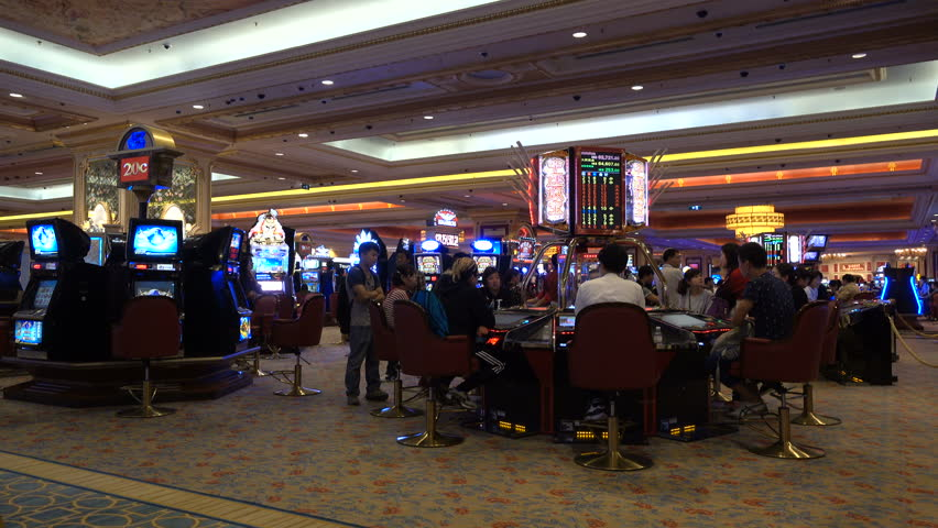 MACAU - 24 OCTOBER 2015: Mainland Chinese visitors play various gambling games inside the Venetian Macao, one of the most expensive casinos in the world
