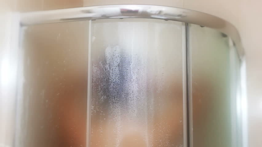 A young woman is showering in the shower, Showering in the Shower Cabin, Video Clip