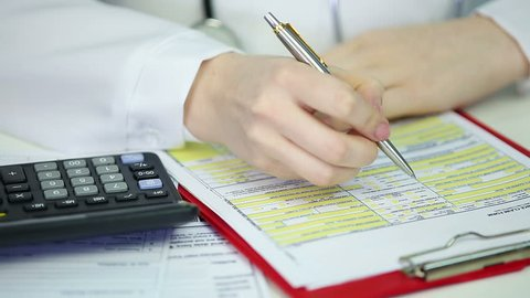 Female therapist filling out health insurance claim form calculating expenses. Doctor with stethoscope writing patient information in document, medication charge, clinic service, expensive treatment