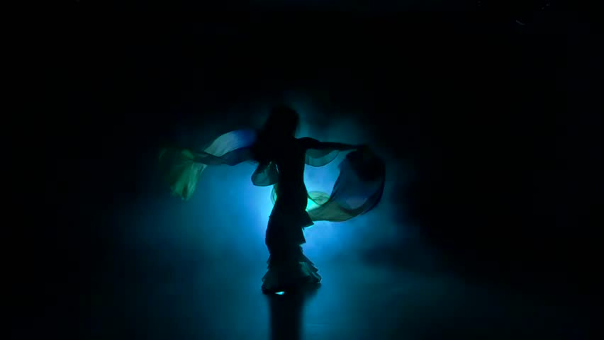 Beautiful exotic belly dancer woman continue dance, uses fans, on black, slow motion, silhouette, smoke