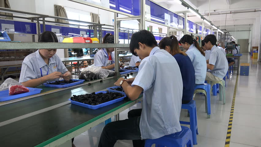 Shenzhen A & H Design Home Limited Part - 34: SHENZHEN, CHINA - 16 NOVEMBER 2015: Chinese Factory Workers On The Assembly  Line Of