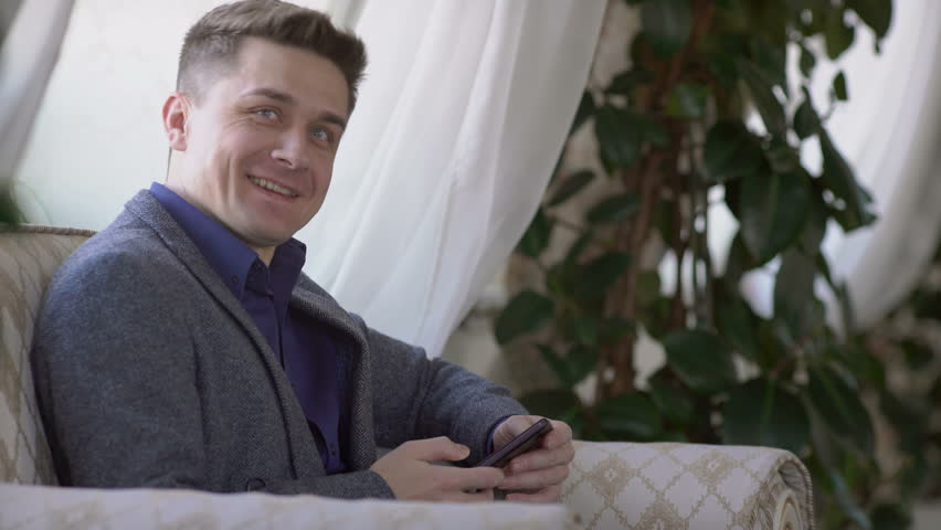Handsome man working with smartphone and documents  | Shutterstock HD Video #14918680