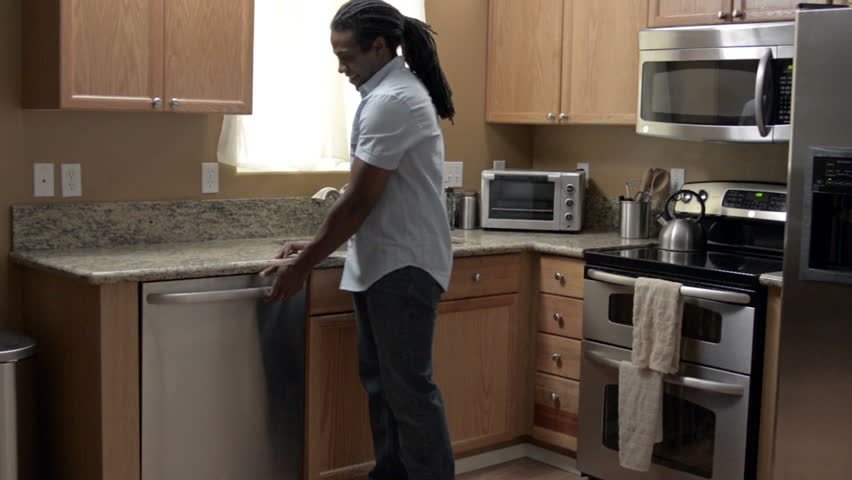 A Modern African American Family completes tasks around the house from paying bills, cleaning, to celebrating with each other.
