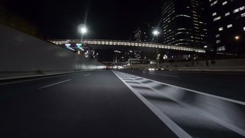 Midnight drive through the empty Tokyo Bayshore Highway through the modern creations over reclaimed lands in Odaiba.