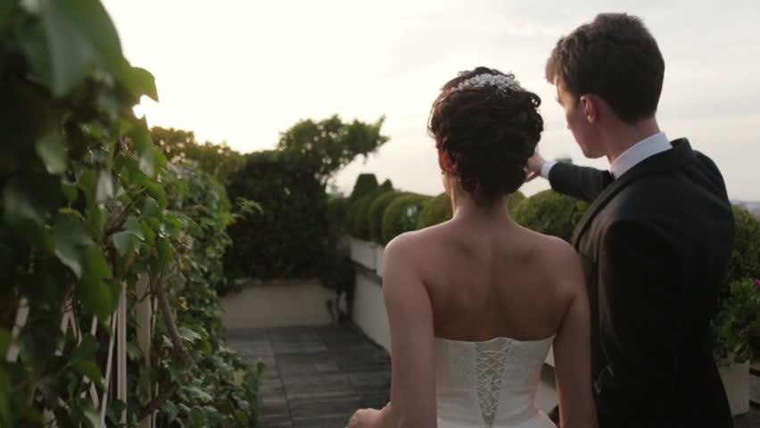 Aristocratic wedding couple walking on Elysian Fields in Paris. Back view | Shutterstock HD Video #15031750