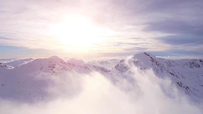 Aerial Drone Flight Over Mountain Range Through Clouds At Sunset Morning Mist Sun Light Flare Sunrise Beauty Inspiration Religion Worship God'S View Concept UHD 4K