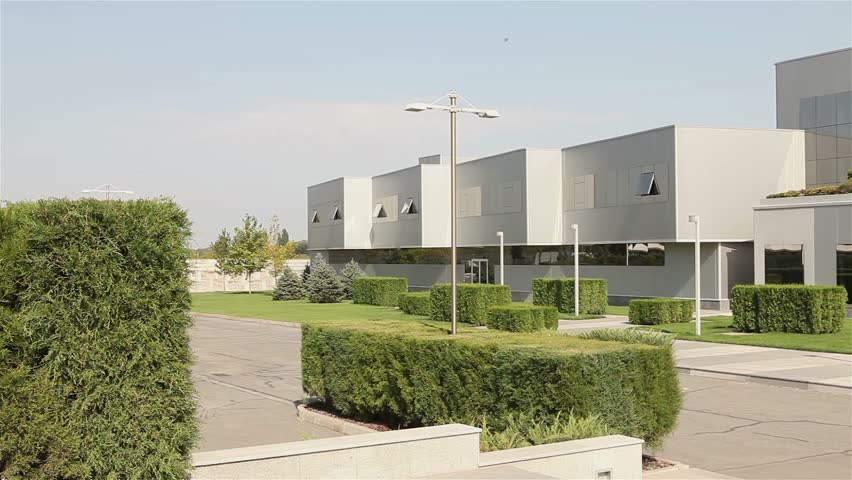 Modern plant building exterior with air ceramics tiles for Modern factory building design