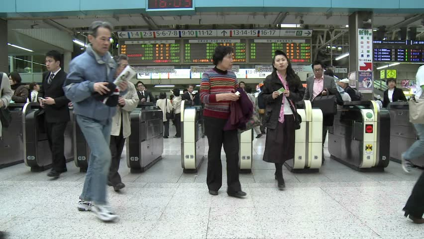 TOKYO - CIRCA 2009:  (Timelapse View) Commuters pass through the turnstiles in Ueno station during rush hour circa 2009 in Tokyo, Japan.
