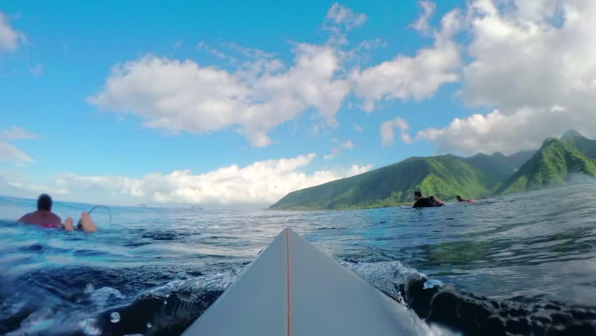 FPV SLOW MOTION: Pro surfer paddling and catching big barrel wave Teahupoo in famous surf spot in sunny Tahiti island