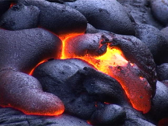 Cooling crust shows fiery hot molten lava underneath.