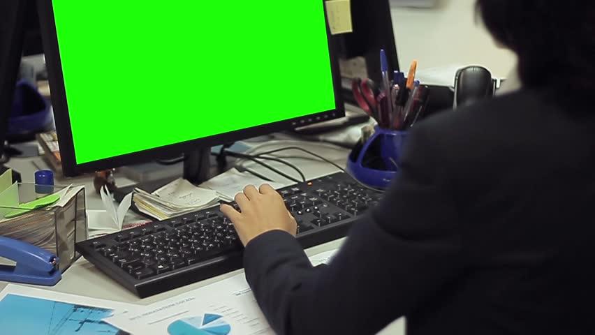Woman using computer with green screen   Shutterstock HD Video #15210757